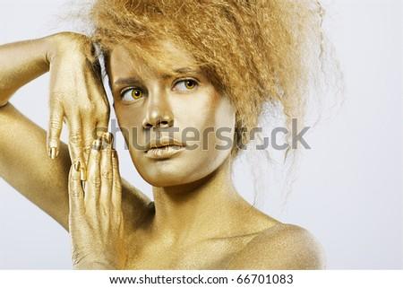 portrait of girl with golden bodyart on gray