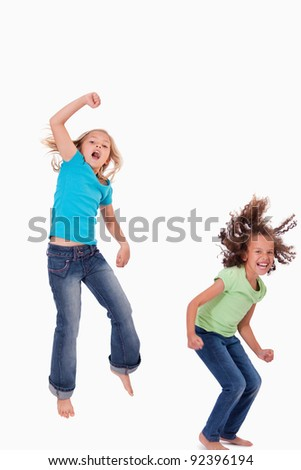 Portrait of girls jumping against a white background