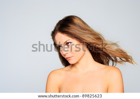 Portrait of glamour beautiful young woman with long hair