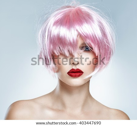 Portrait of glamour girl with red lips and pink hair isolated on blue background