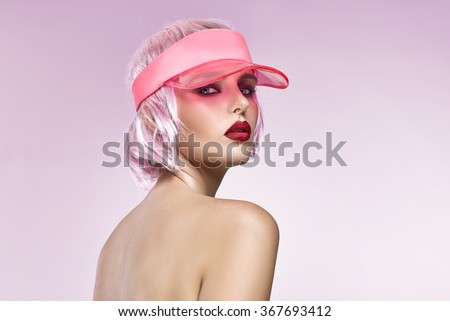 Portrait of glamour girl with red lips isolated on pink background