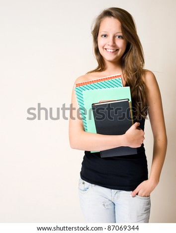 Portrait of gorgeous charming young brunette student girl. - stock photo