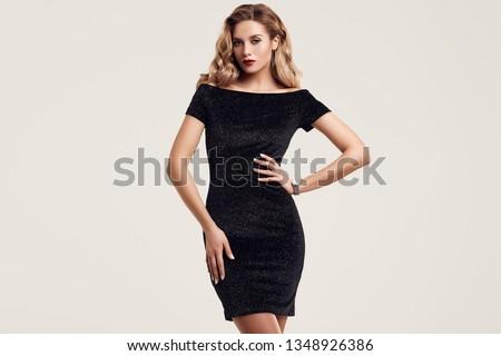 Portrait of gorgeous elegant sensual blonde woman wearing fashion black dress isolated on white background #1348926386
