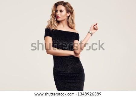 Portrait of gorgeous elegant sensual blonde woman wearing fashion black dress isolated on white background #1348926389