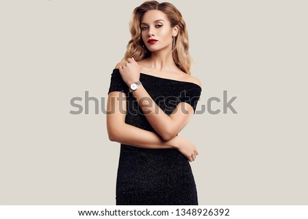 Portrait of gorgeous elegant sensual blonde woman wearing fashion black dress isolated on white background