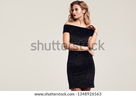 Portrait of gorgeous elegant sensual blonde woman wearing fashion black dress isolated on white background #1348926563