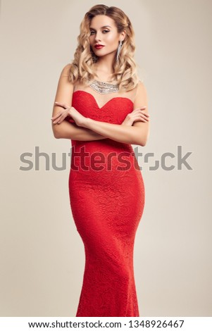 Portrait of gorgeous elegant sensual blonde woman wearing fashion red dress isolated on white background