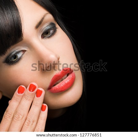 Portrait of gorgeous sensual brunette woman with bright red lips and nails. - stock photo