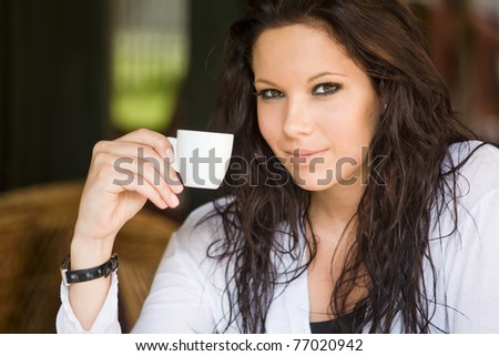 Portrait of gorgeous young brunette at the coffee shop.