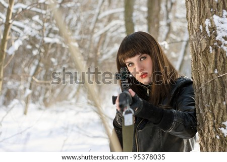 Portrait of gorgeous young woman with a sniper rifle