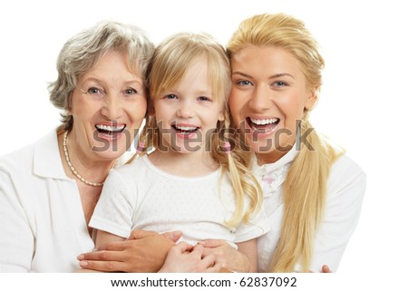Portrait of grandmother with adult daughter and grandchild laughing