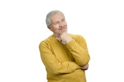 Portrait of grandpa in thoughtful pose. Concept of pensive grandfather. White isolated background.