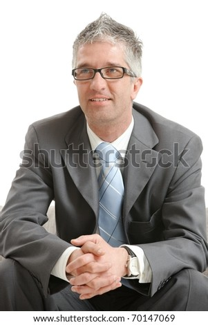 Portrait of gray haired happy businessman, smiling. Isolated on white background.?