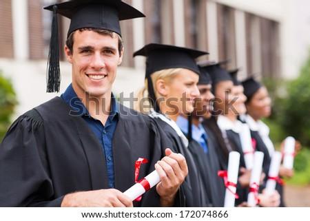 portrait of group cheerful college graduates at graduation