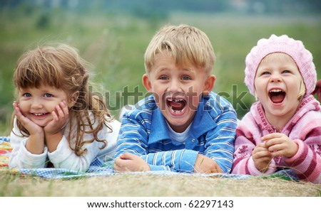 stock-photo-portrait-of-group-laughing-children-lying-on-the-grass-62297143.jpg