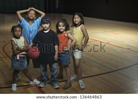 Portrait of group of children with basketball