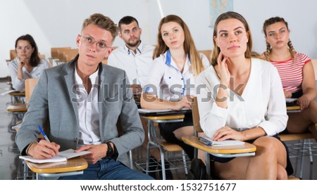 Portrait of group of different age people in lecture hall at extension courses #1532751677