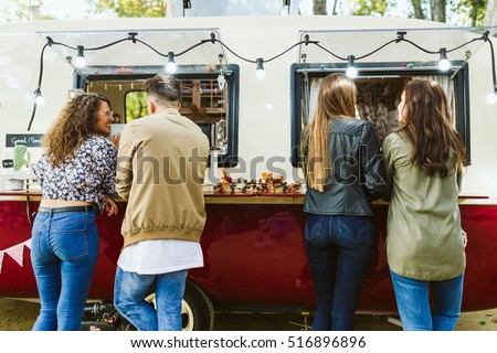 Portrait of group of friends visiting eat market in the street. #516896896