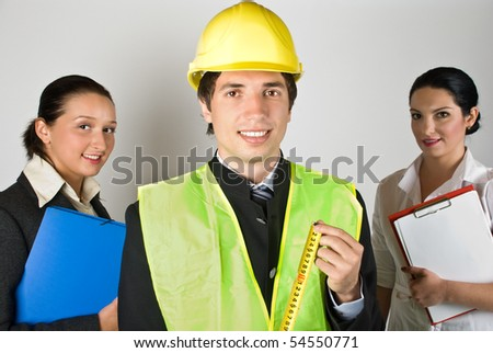 Portrait of group of people workers ,architect man in front of image showing a measurement tool