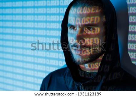Portrait of guy on blue neon light digital interface background. Young man with beard. Digital art. Projector light illumination on face. Stock photo ©