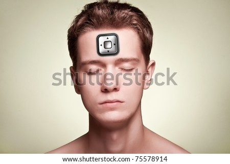 Portrait of guy with joystick in the forehead. Control man.