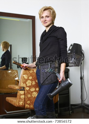 Portrait of  hairdresser at her work place