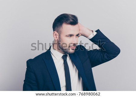 Shutterstock Portrait of half turned stunning ideal boss touching his hair looking to the side over grey background