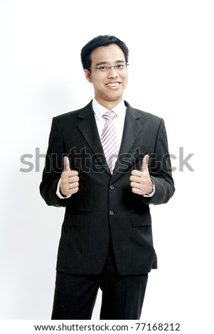 Portrait of hand showing goodluck sign against white background