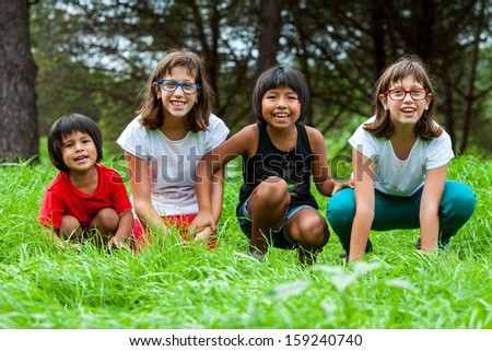 Portrait of handicapped girls with latin friends on farm.