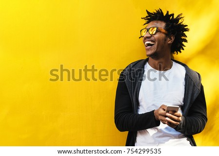 Portrait of handsome afro man using his mobile. Stock foto ©