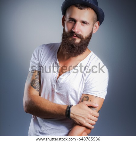 Portrait of handsome bearded man in hat standing , isolated on  #648785536