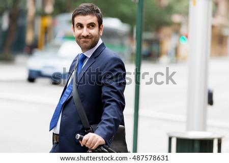 Portrait of handsome businessman outdoor #487578631