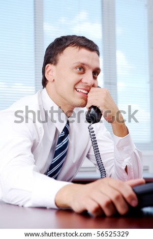 Portrait of handsome businessman thinking about something good in office