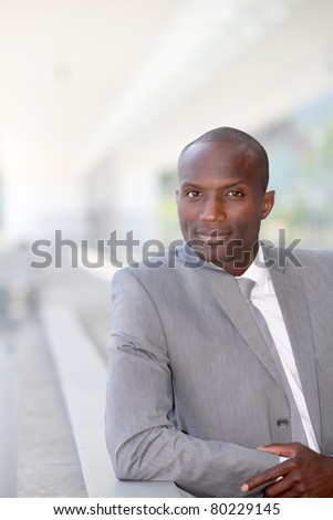 Portrait of handsome businessman wearing grey suit