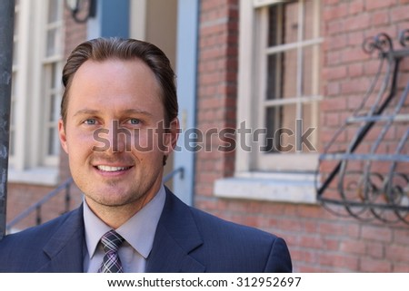 Portrait of handsome clean cut businessman in London