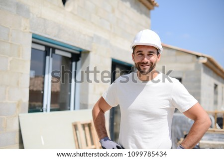 portrait of handsome construction worker on a house building industry construction site Сток-фото ©
