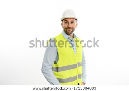 portrait of handsome foreman architect wearing yellow reflective vest and a hard hat studio shot isolated on white background ストックフォト ©