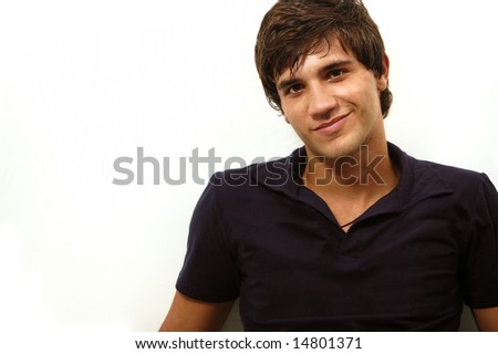 Portrait of handsome hispanic teenager smiling - isolated