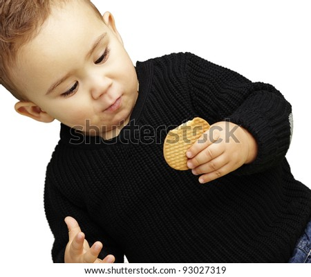 portrait of handsome kid eating a biscuit against a white background