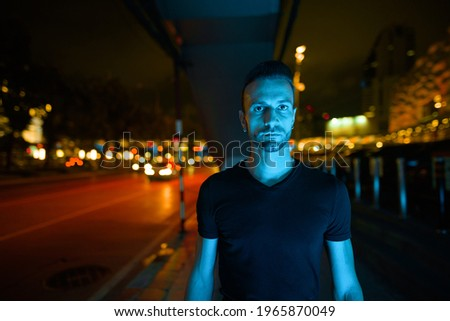 Portrait of handsome man at night in city streets Foto stock ©