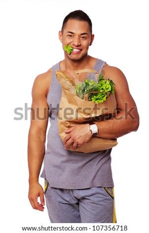 Portrait of handsome man eating salad