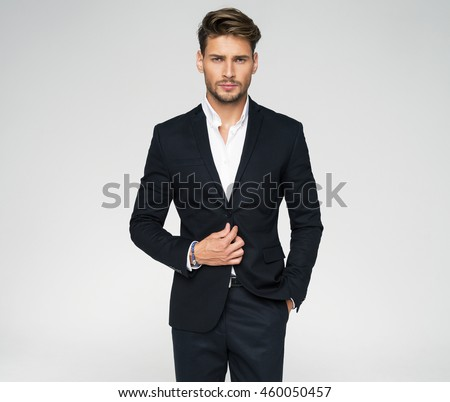 Portrait of handsome man in black suit #460050457