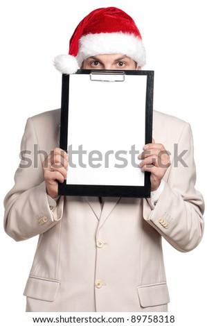 Portrait of handsome man in santa hat on white background