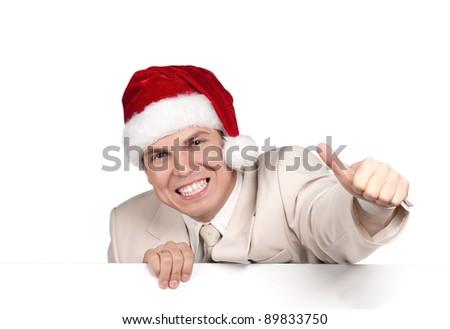 Portrait of handsome man in santa hat with blank billboard on white background