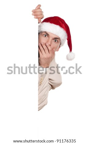Portrait of handsome man in santa hat with blank billboard on white background