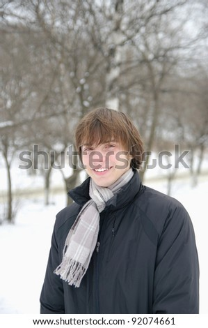Portrait of handsome man in scarf and coat.