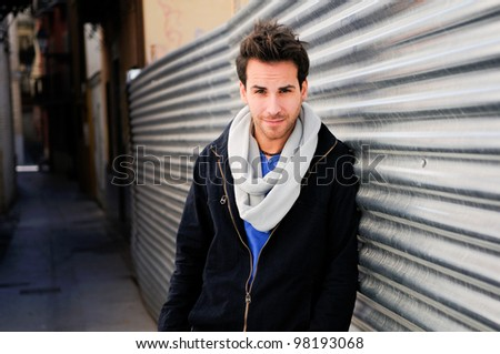 Portrait of handsome man in urban background