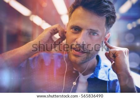 Portrait of handsome man listening music in train #565836490