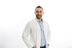 portrait of handsome man male doctor in hospital with a white lab coat studio shot isolated on white background
