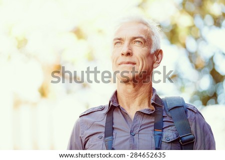 Portrait of handsome man outdoors